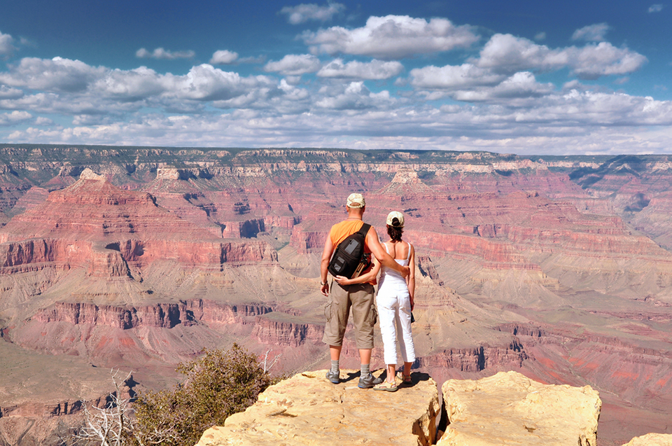 People look out on the Grand Canyon
